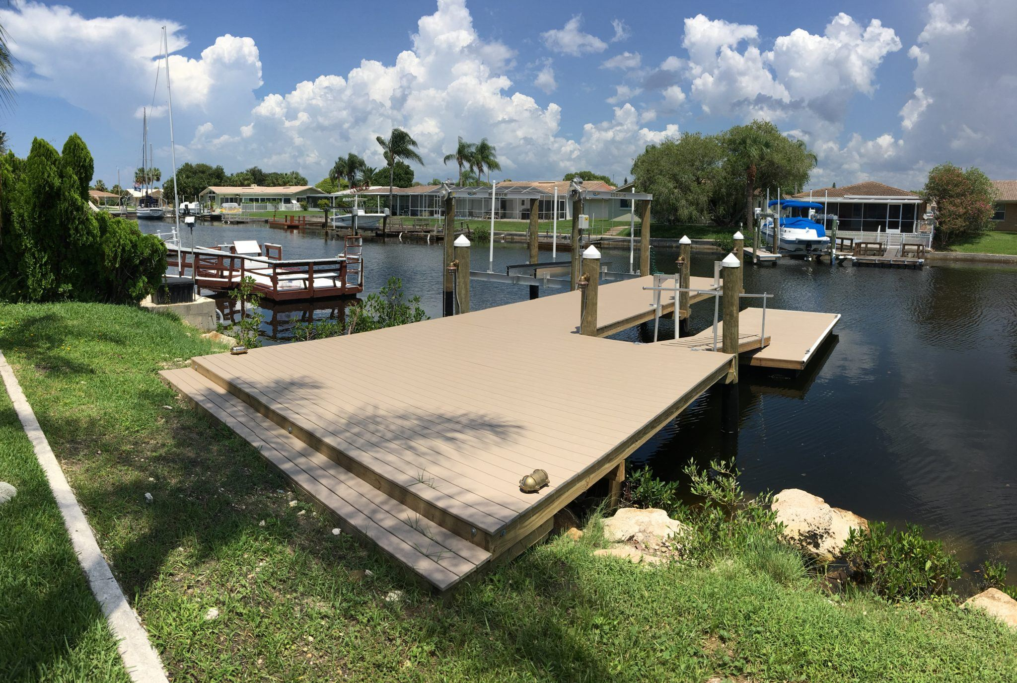 A Trex stationary dock with a composite floating dock attached with an aluminum boat lift