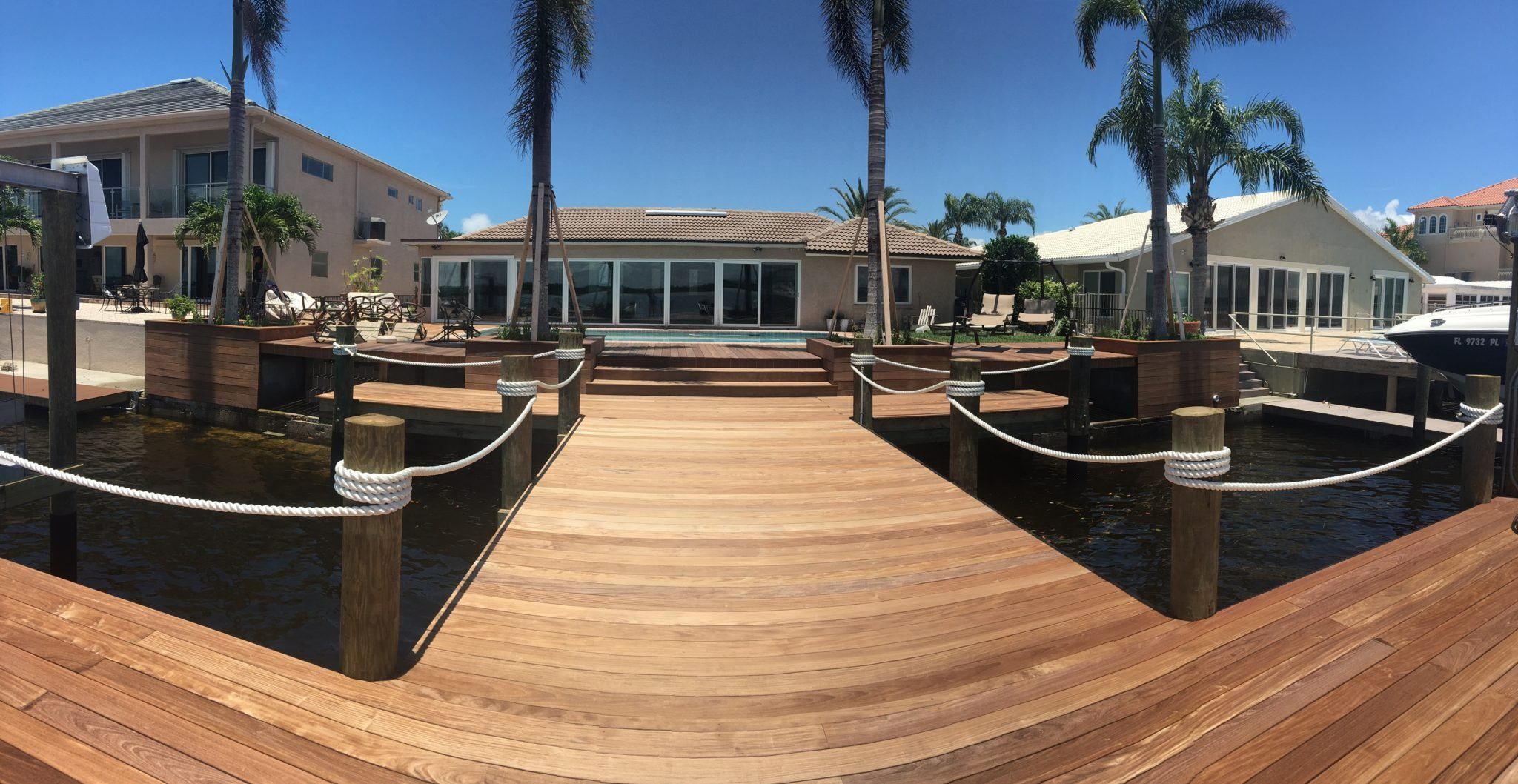 A composite deck with composite planter boxes on the water
